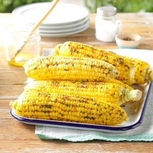 sweet corn freshly harvested and grilled outside